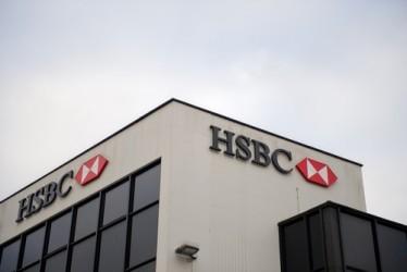 HSBC, utile 2014 in calo e sotto attese, il titolo crolla