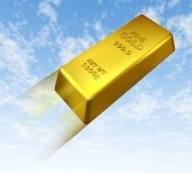 Il prezzo dell'oro vola e chiude poco sotto 1.200 dollari