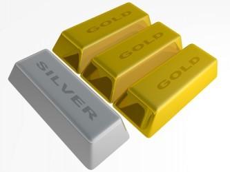 Metalli: La forza del dollaro pesa sui prezzi di oro e argento