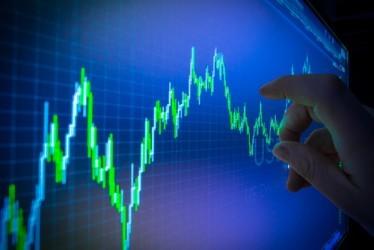 Borsa Milano in leggero rialzo a metà giornata, alta volatilità
