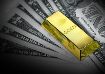 Metalli: Il prezzo dell'oro frena su prese di beneficio