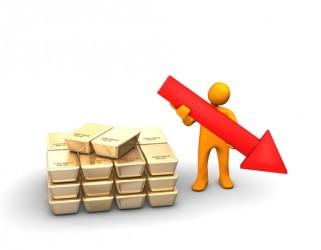 Oro zavorrato dal dollaro, settimo ribasso in otto sedute