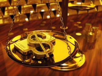 Prezzo oro in calo, hedge fund riducono esposizione sul metallo giallo