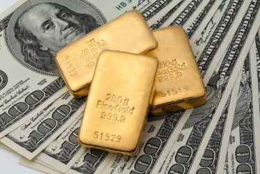 Prezzo oro ancora in calo, ma per UBS risalirà a 1.350 dollari